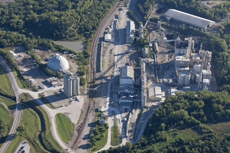 Conveyor belt generates power for air cannons to control build-up at US cement plant